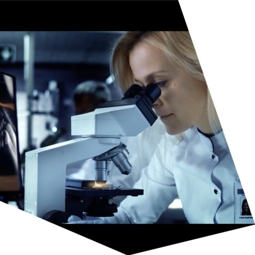 Woman at microscope during quality check | © EOS